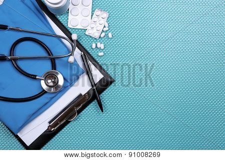 Medical supplies on blue table close-up