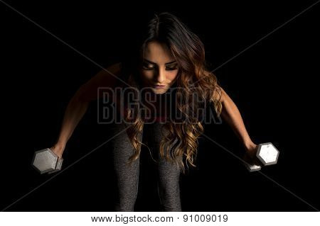 Woman In Pink Sports Bra On Black Weights Lean Forward