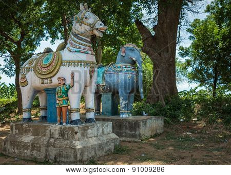 Road-side Statues Of Horse And Elephant.