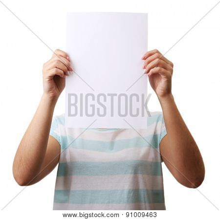 Woman covering her face with blank sheet of paper isolated on white