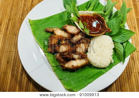 Fried Pork And Sticky Rice With Sauce On Dish