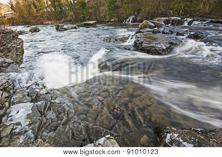 Small River Waterfall In Rural Setting