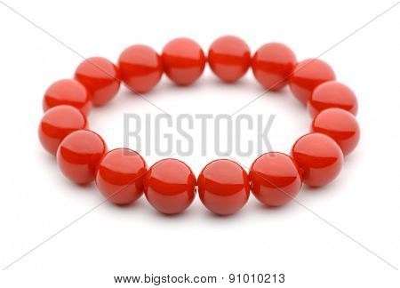 Red glass bracelet isolated on white