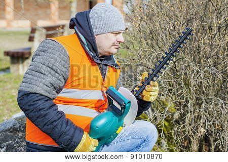 Landscape worker check bush cutter