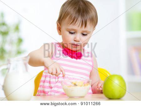 Cute little girl eats healthy food