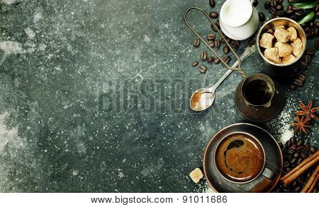 Top view of Espresso coffee, milk and sugar on black marble table. Background with space for text.
