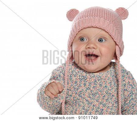 baby girl child  smiling happy pink fashion portrait face studio shot isolated on white caucasian  hat warm clothing