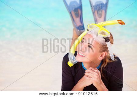Happy diver woman lying down on beautiful sandy coast, enjoying summer water sport, active lifestyle, joyful vacation on beach resort