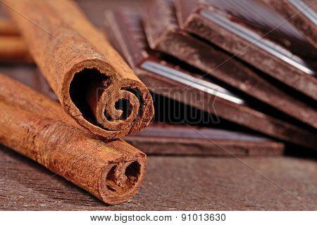 Cinnamon Sticks And Pieces Of Chocolate