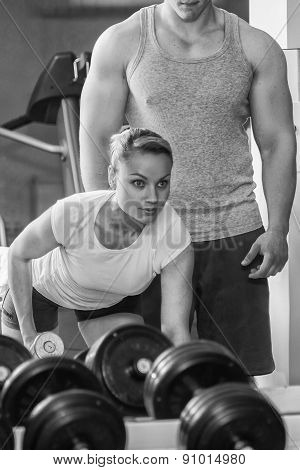Man and woman trained in the gym