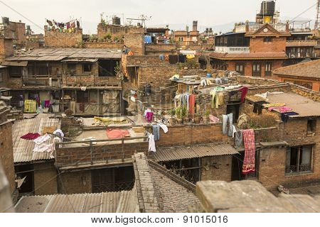 BHAKTAPUR, NEPAL - CIRCA DEC, 2013: Nepali houses in the city center. The caste system is still intact today but the rules are not as rigid as they were in the past.