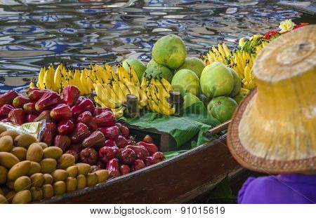 Small boat loaded with colourful fruits, Thailand