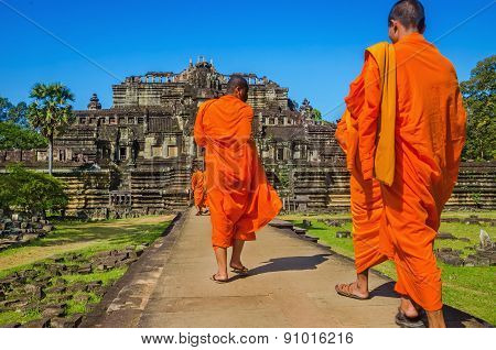 Buddhist monks in traditional orange robes
