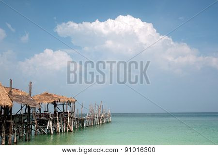 Traditional wooden bridge of Thai Style On The Beach.