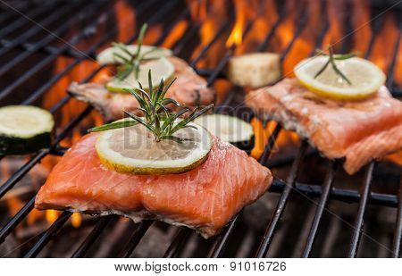 Delicious grilled salmon steaks on fire