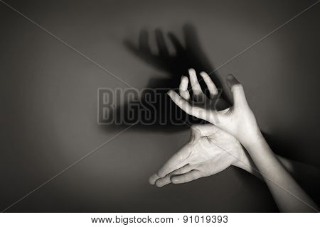 Hands gesture like deer on gray background