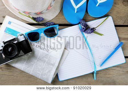Tourist stuff on wooden background