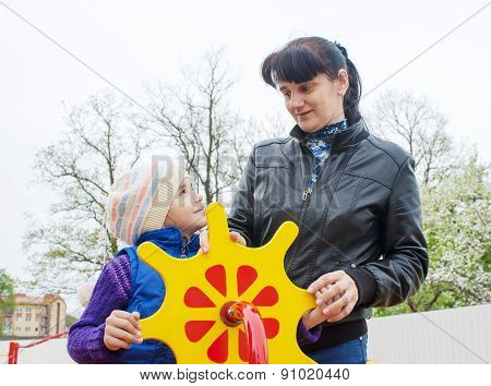 Mom Plays With Her Daughter On A Toy Ship