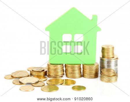 Model of house with coins isolated on white