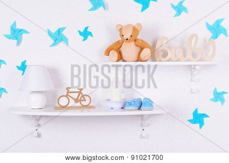 Baby accessories on shelves close-up