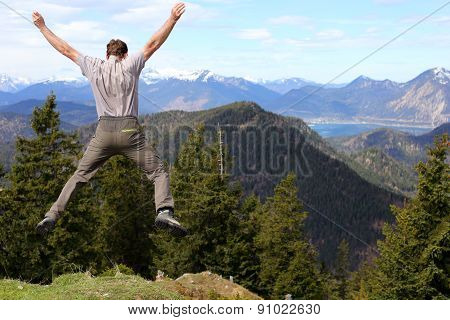 Happy Hiker Is Jumping High