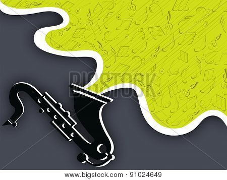 Black saxophone with musical notes on dark grey background.