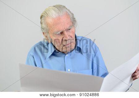 Elderly Man Holding A Blank Big White Paper Sheet