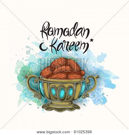 Islamic holy month of prayers, Ramadan Kareem, Iftar party concept with dates on blue color splash background.