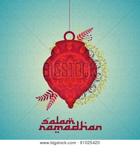 Hanging beautiful lantern on beautiful floral decorated background for welcoming to the Islamic holy month of Ramadan Kareem with stylish text