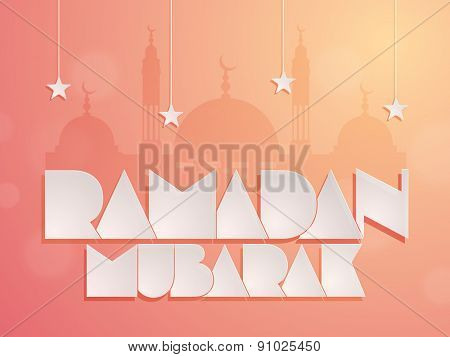 Stylish paper text Ramadan Mubarak with silhouette of mosque and hanging stars for Islamic holy month of the prayers.