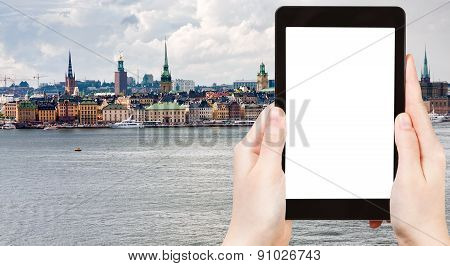 Tourist Photographs Stockholm City In Autumn Day