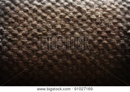 Primitive wool knit or weaving close up. Shallow depth of field.