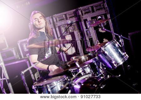 Man playing drums live. Concept live music