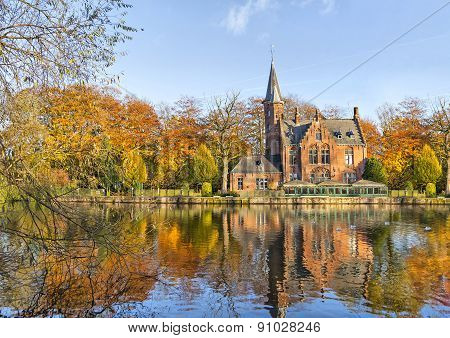 Flemish Style Building Reflecting In Minnewater Lake, Bruges