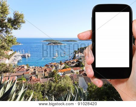 Tourist Photographs Town On Hvar Island In Croatia