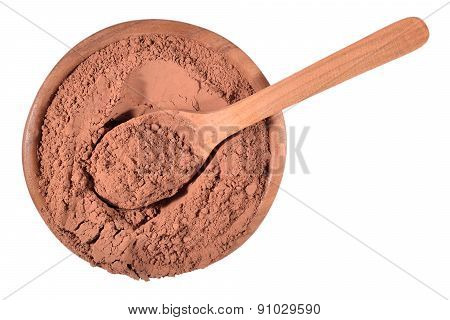 Cocoa Powder In A Wooden Spoon On A White