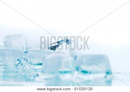 Fresh cool ice cubes macro close up isolated on white