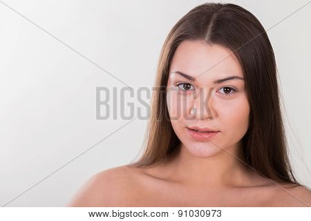 Brunette posing on a white background. Beautiful make-up lips