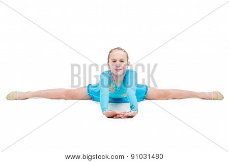 Cute little girl sits on a splits