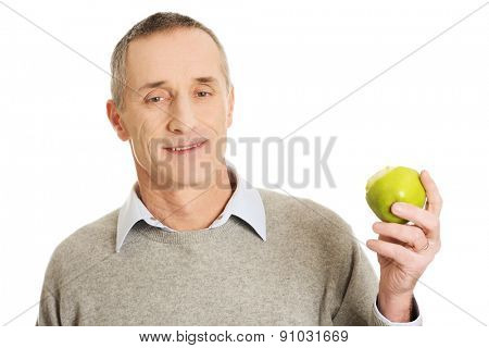 Portrait of mature man with an apple.