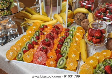 Carved fruits arrangement. Fresh various fruits. Assortment of exotic fruits. Fresh fruits