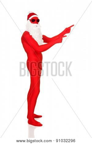 Side view of santa man in latex clothing pointing.