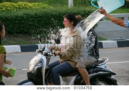Unidentified Tourist With Motorcycle In A Water Fight Festival (chiangmai,thailand)