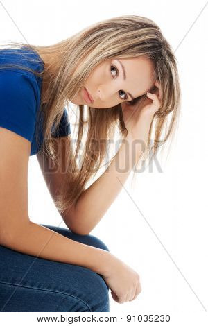 Portrait of depressed woman scratching her head.
