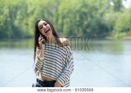 portrait of a smiling woman with phone