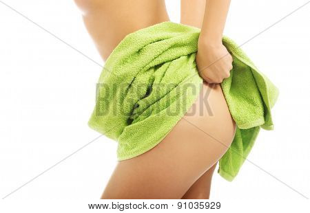 Close up on woman showing her buttock.