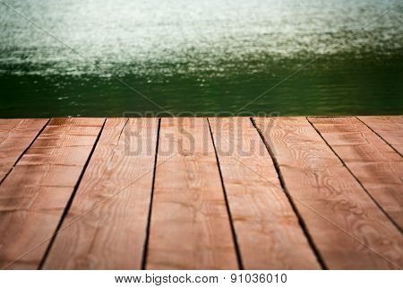 Edge Of Wood Deck Near Water