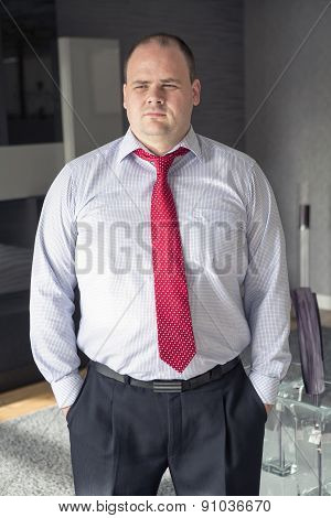 Businessman Standing And Looking Thoughtful