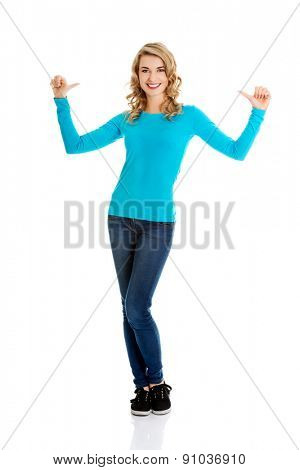 Full length woman pointing on herself.