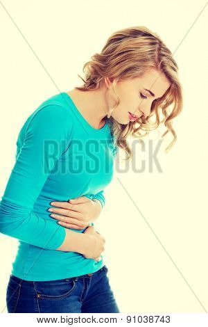 Young woman with stomach issues